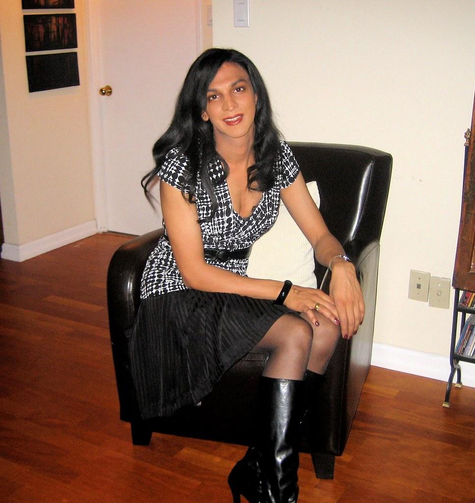 Crossdresser pose for webcam in knee boots