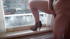 Naughty sex near an open window voyeur videos