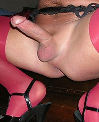 Sexy nylon jane plays with a crossdresser in pink