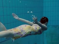 Sexy girls swimming underwater